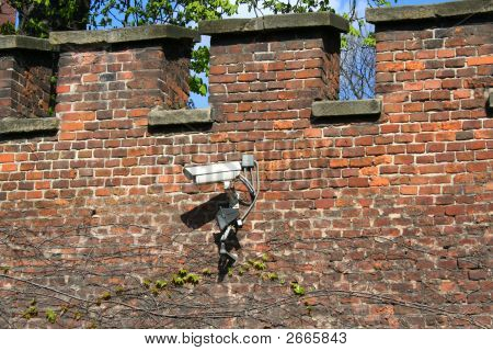 Secuity Camera On Wall From The Bricks.