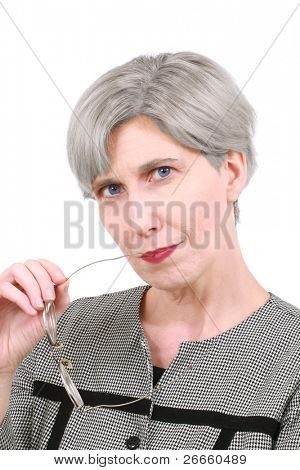 Woman biting on her glasses