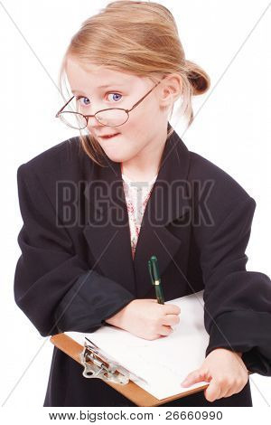 Cute little girl pretending to be a business woman