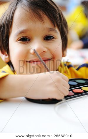 Cute kid painting