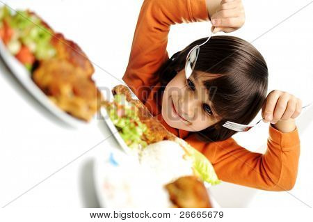 beautiful kid boy is about to eat, real enjoying food