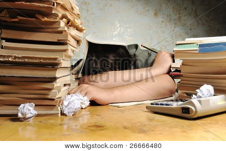 Businessman sleeping in the office