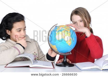 Two little girl  with globe  on white