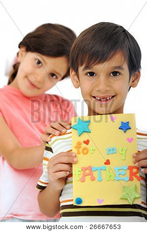 Happy kid preparing greeting card for mother and father