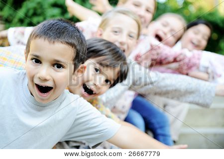 happy children together outdoor, faces,