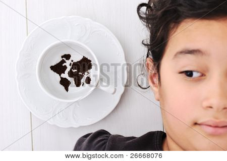 World map: Kid with seed made globe on the plate