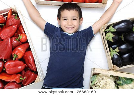 Happy kid with vegetables, harvest collecting time