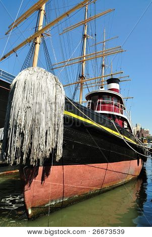 A historic tug boat at South Street Seaport in New York City.