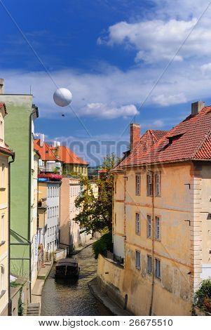 Hot air balloon over a the Chertovka River, a small tributary off the Vltava River, in Prague, Czech Republic.