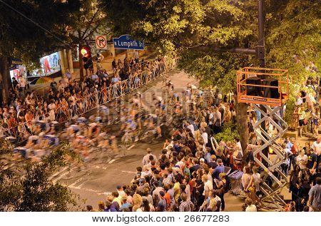 ATHENS, GEORGIA - MAY 30: Cyclists round a turn in Athens Twilight Criterium, the first nighttime race in the United States May 30, 2011 in Athens, GA, USA.