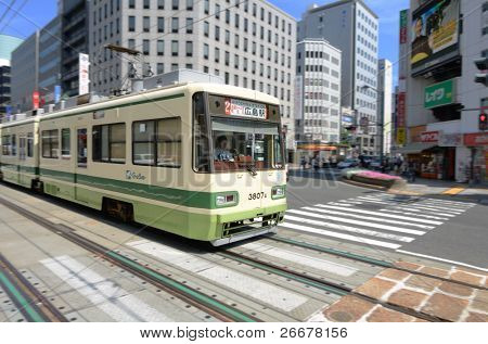 HIROSHIMA, JAPAN - JULY 16: Being located on a delta, Hiroshima opted to keep their tram line from the 1980's while other cities abandoned them for subway systems July 16, 2011 in Hiroshima, Japan.