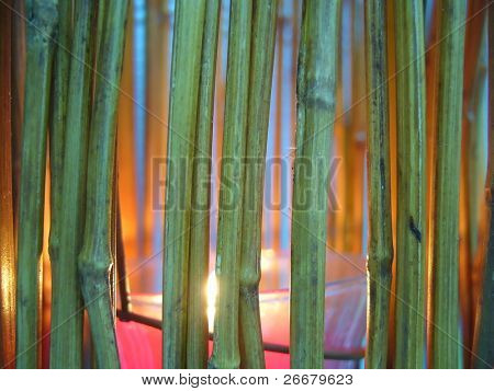 The fire light of candle through the bamboo cage