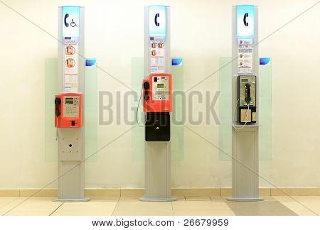 Three telephone booths