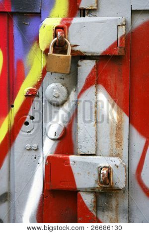 padlock on a brightly colored wooden door