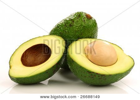 one whole and one cut avocado