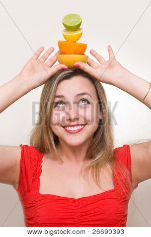 Woman Holding Fresh Fruits