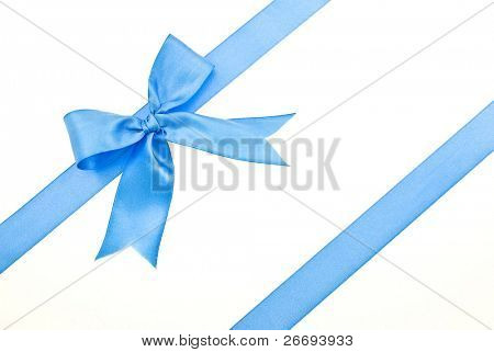 Gift packaging with blue ribbons and bow isolated on white