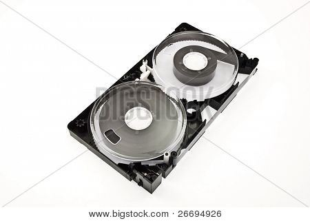 Open video cassette isolated on white