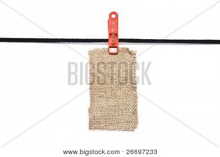 Sackcloth tag on clothes-peg