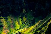 Landscape Detail Of Na Pali Coast Cliffs With Helicopter In Distance, Kauai, Hawaii poster