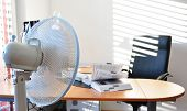 stock photo of leaf-blower  - Fan in the office leafing a book - JPG