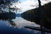 Nature of Sweden in autumn, Calm Stora Kedjen lake with wooden bridge and reflecting forest, Peacefu poster