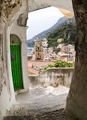 arch on view of village and bell tower Amalfi