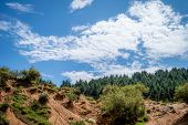 Landscape Photo Of Rain Water Erosion Landcape With Blue Cloudy Sky poster