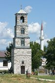 stock photo of coexist  - belltower of orthodox church and minaret of musulman mosque in republic of Macedonia - JPG