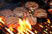 stock photo of metal grate  - Hamburger patties on the grill - JPG