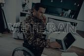 Military Veteran. Disabled Man In A Wheelchair. Man Sitting At Table. Man Using S Laptop. Man Is Sol poster