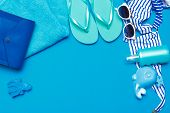Beachwear And Accessories On A Blue Background poster