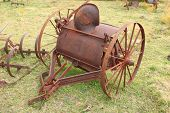 stock photo of horse plowing  - Antique farming equipment left on abandoned fields  - JPG