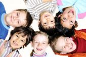 foto of children playing  - Small group of happy children outdoor - JPG