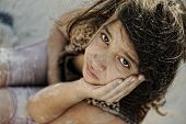 stock photo of tragic  - Poverty and poorness on the children face - JPG