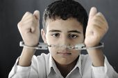 Kid with handcuffs on hands