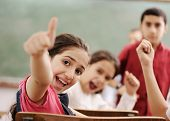 foto of little school girl  - Happy children with their teacher in classroom - JPG