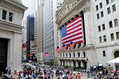 NEW YORK CITY - MAY 27: The historic New York Stock Exchange on Wall Street with crowds below, one o