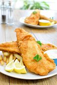 picture of hake  - Traditional english fish and chips meal with two plates - JPG