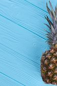 Hawaiian Ananas And Copy Space. Tasty Exotic Pineapple Fruit On Blue Wooden Surface And Text Space. poster