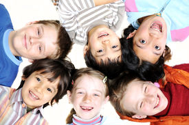 stock photo of children playing  -   Small group of happy children outdoor - JPG