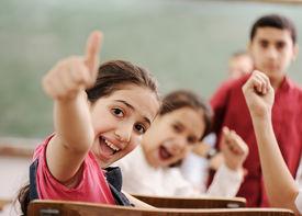 pic of little school girl  - Happy children with their teacher in classroom - JPG
