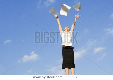 Woman Throwing Paperwork In Air