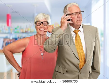 senior Man Communicating On Mobile Phone, Indoor