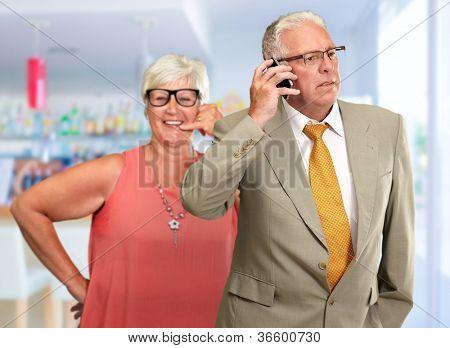 senior Man Communicating On Mobile Phone, Indoor