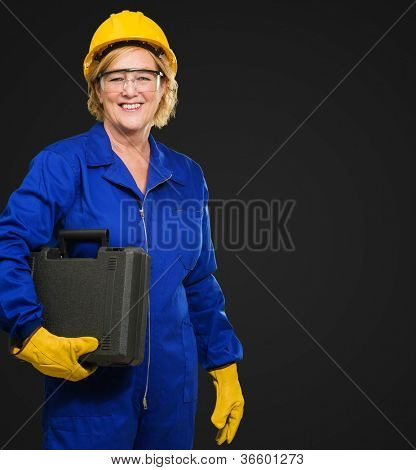 Woman Architect Holding Toolkit On Black Background