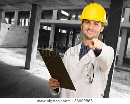 Technician Holding Clipboard At Construction Site