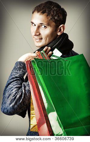 Fashion Man Holding Shopping Bags