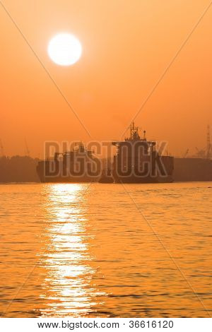 Containerships And Misty Red Sunrise