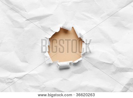 Milky circle shape breakthrough crumpled paper hole with white background